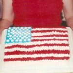 """2001-Kevin and April came for July 4th, about a week and a half after they got married. I said, """"April, why don't you make our flag cake."""" And, what a trooper, she did."""