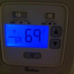 Right now, for example, I'm sitting in my chilly house, all bundled up, with the thermostat set at 69°.
