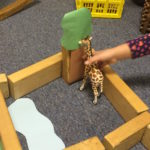 "and included such touches as ""this giraffe is eating leaves from this tree."""