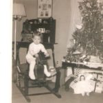 This is me, age 1-and-a-half, at my grandparents' home in Hillsboro, TX. I'm so sorry the top of the tree isn't in the shot. I'd like to know what's on the top.