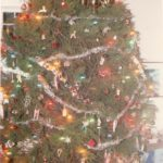 One year, tinsel garland. And, see, at the tree's top, you can't see that hook in the ceiling at all, can you!