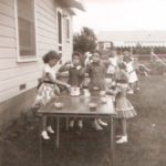 Different backyard, different house, my 6th birthday party. The card table, still looking sharp and sturdy.