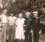 My grandmother in the center. From the left: her brother, Frank, her Army son (Ozero, my Dad), Grandma, her Navy sons (C.L. and Joe)--they all came home alive