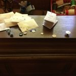"""Little envelopes, labeled with the clothing to which the buttons belong, buttons to clothes I no longer have that will go into the """"loose buttons"""" container (for other projects), and empty envelopes on their way to the recycle bin"""