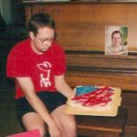 In 2000, Kevin was away, and Jeremy tried a more artsy sort of flag, but was disappointed at the result. Kevin's photo, however, likes the cake just fine.